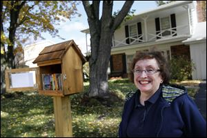 Marilyn Machosky, and her husband Stan, have officially opened their neighborhood library in the front yard of their home in Sylvania. Any passerby may take a book and though patrons are encouraged to return them, it is not necessary to bring the same book back.