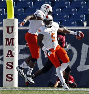 Bowling Green linebacker Dwayne Woods (5) celebrates with teammate Gabe Martin, left, after Woods intercepted a pass and ran it back for a touchdown in the third quarter of Saturday's game.