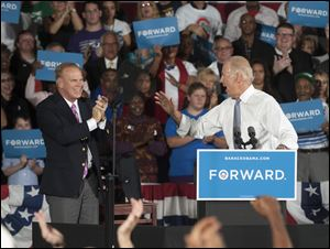 Former Ohio Gov. Ted Strickland applauds as Vice President Joe Biden reacts from the crowd during a campaign stop today at the J. Babe Stearn Community Center in Canton, Ohio.