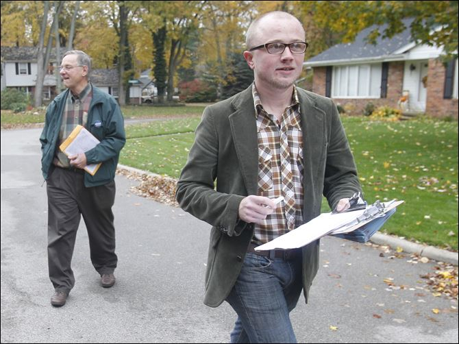 Denis Eble, left, and Evan Morrison head  Denis Eble, left, and Evan Morrison head down Brookhurst Road in Sylvania as they go door to door on behalf of President Obama's re-election campaign. Crystal Bowersox also campaigned for the President last weekend.