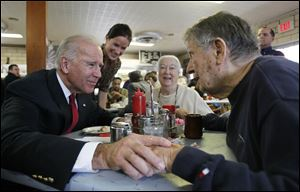 Vice President Joe Biden, with his daughter Ashley Biden, standing, talks with Ed Nazar and his wife Ann Monaghan Nazar during a campaign stop at Schmucker's Restaurant.