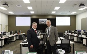 Ray Lieb, left, site vice president of Davis-Besse, and Fred Petersen, right, of Ottawa County EMA director, in the Davis-Besse Nuclear Power Station's new Emergency Operations Facility.