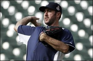 Detroit Tigers pitcher Justin Verlander throws during a workout at Comerica Park on Monday in Detroit.