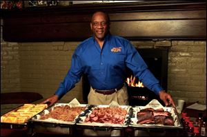 Former Detroit Lion and Heisman Trophy winner running back Billy Sims displays the fare at his Billy Sims Barbecue.