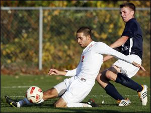 Sylvania Southview's Samer Sarsour (12) moves the ball against  St. John's Jeff Anderson (4) during a Division I boys district soccer semifinal in Sylvania. Southview defeated St. John's 2-1.