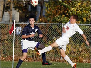 Sylvania Southview's Matt Turley (10) kicks the ball against St. John's Bailey Crawford (12).
