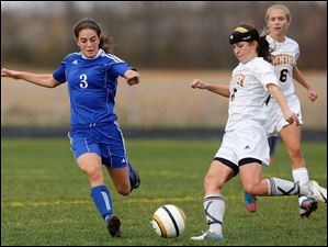 Anthony Wayne's Abby Allen (3) moves the ball against Sylvania Northview's Ashley Ingle (8).