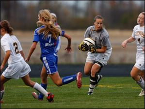 Sylvania Northview goalie Kelly Shoemaker (1) makes a save against  Anthony Wayne Tuesday afternoon.