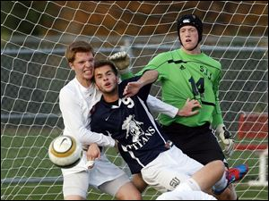 St. John's goalie Eric Mihaly (14) and Nick Gramza (9) defend the net against Southview's Chris Ellis (16).