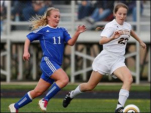 Anthony Wayne's Jessie Mattimoe (11) and Northview's Rachel Bules (22) chase the ball down the field.