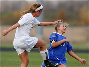 Sylvania Northview's Erin Bishop (15) kicks Anthony Wayne's Allana Bell (17) as she tries to move the ball.