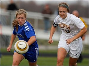 Anthony Wayne's Katie Coburn (20) and Northview's Lauren Yurjevic (18) eye the ball as it heads downfield.