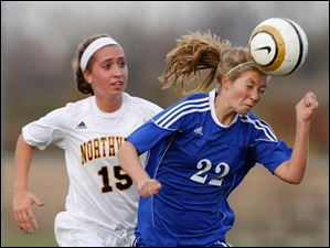 Anthony Wayne's Rachel Nutter (22) moves heads the ball away from Sylvania Northview's Erin Bishop (15).