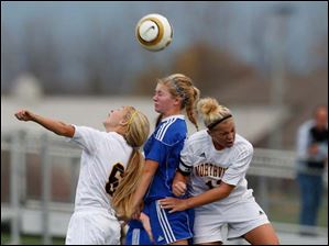 Anthony Wayne's Susan Nutter (16) battles Sylvania Northview's Megan Kupetz (16) nad Laura Connor (13) for the ball.
