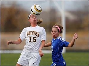 Northview's Erin Bishop (15) hits the ball against  Anthony Wayne's Baily Hertzfeld (18).