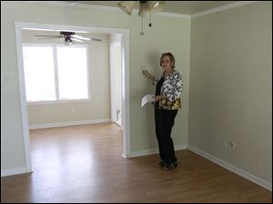 Realtor Kimi George shows a new home for sale in The Village, Okla., last month.