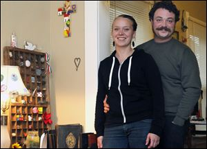 Julia Bertalan, left, and her husband Dylan Wilson, right, in their East Toledo home.