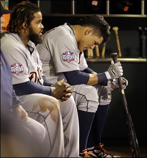 Detroit Tigers' Avisail Garcia and Prince Fielder, left, sit on the bench Wednesday during the ninth inning of Game 1 of baseball's World Series against the San Francisco Giants.