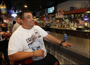 DJ Pablo Urbina takes a break from spinning records at  Senor Toros in East Toledo.