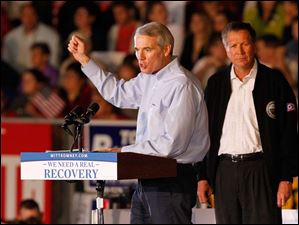 U.S. Senator Rob Portman and Ohio Gov. John Kasich speak at a rally for Republican presidential candidate Mitt Romney.