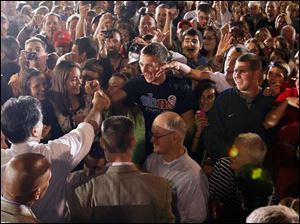 Republican presidential candidate Mitt Romney greets supporters.