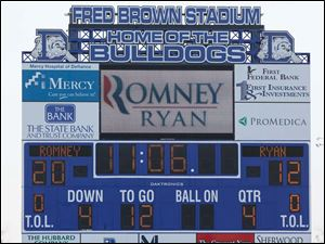 The scoreboard during the rally so Election Day as the time and the election year as the score.