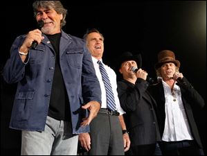 Musicians from left Randy Owen, John Ridge, and Big Kenny flank  Republican presidential candidate Mitt Romney.