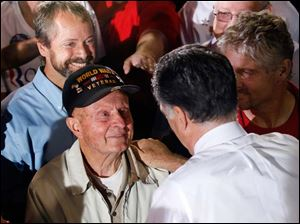 On the other end of the age spectrum, Romney greets a senior supporter.