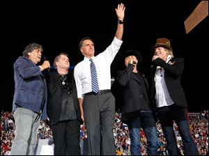 Musicians from left Randy Owen, Meatloaf, John Ridge, and Big Kenny flank Republican presidential candidate Mitt Romney.