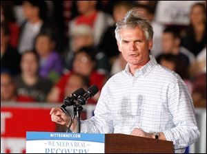 Congressman Bob Latta speaks at a rally for Republican presidential candidate Mitt Romney.