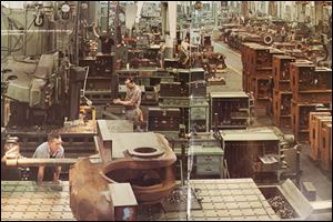 Workers get down to business at National Machinery Co. in 1974. The plant, a few blocks from downtown Tiffin, began operations in that Seneca County community during the 1880s.
