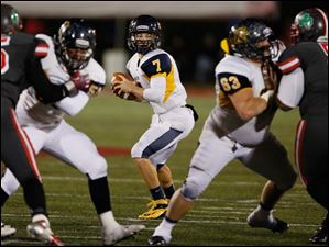 Whitmer quarterback Nick Holley (7) looks to throw against  Central Catholic.