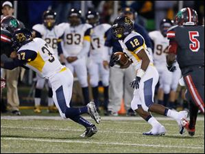 Whitmer running back Tre Sterritt (12) runs the ball against the Irish.