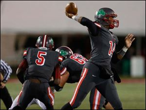 Central Catholic quarterback Deshone Kizer (14) launches the ball against the Panthers.