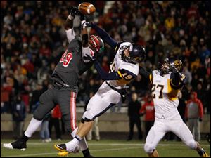 Whitmer Tyler Schneider (19) breaks up a pass intended for Central Catholic's Keith Trowbridge (89) in the end zone.