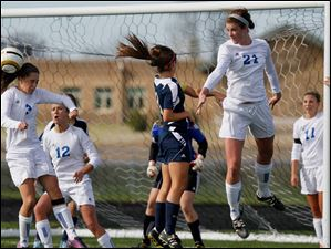 Anthony Wayne junior Abby Allen averts a corner kick during the first half.
