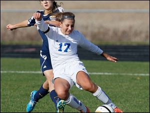 Anthony Wayne senior Allana Bell fights for control of the ball during the first half.