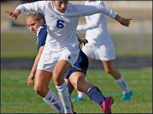 Anthony Wayne junior Chole Brown pushes out a Notre Dame opponent for control of the ball.