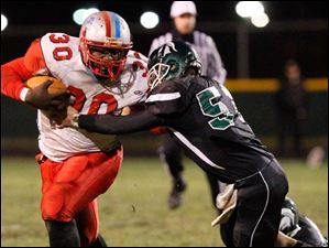 Rebels' Pharaoh Reid attempts to hold off a Start defender while rushing during the first half.