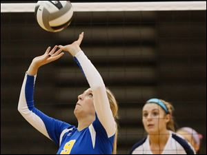 St. Ursula's Emily Lydey (9) sets the ball.