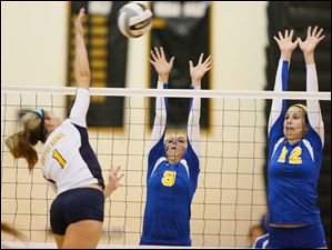 St. Ursula's Emily Lydey (9) and Lauren Daudelin (12) defend against Notre Dame's Payton Bowyer (1).