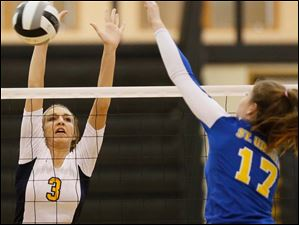 Notre Dame's Morgan Fioritto (3) hits the ball against St. Ursula's Morgan Finn (17).