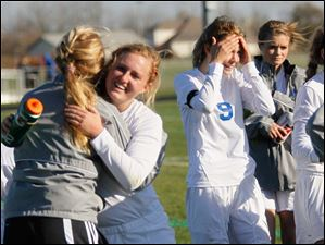 Anthony Wayne senior Erika Sutton celebrates with her teammates after winning Saturday's district final match up against Notre Dame Academy.