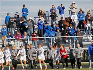 Spectators cheer for the Lady Generals after Anthony Wayne won Saturday's district final match up against Notre Dame Academy.