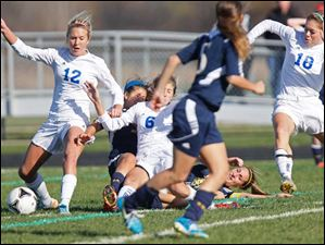 Anthony Wayne junior Katelyn Bixler, left, gains control of the ball.