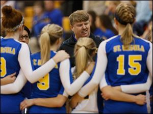 St. Ursula head coach John Buck talks to his team between sets.