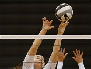 Notre Dame's Stefanie Comte (7) hits the ball against St. Ursula's Madelyn McCabe (2).