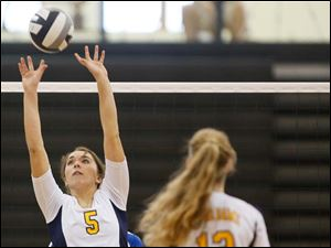 Notre Dame's Madeline Smyth sets the ball against St. Ursula.