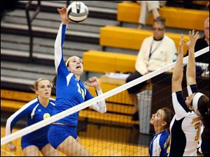 St. Ursula's Lauren Daudelin spikes the ball against  Notre Dame's Stefanie Comte (7).