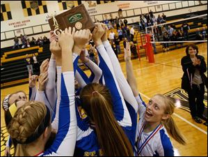 St. Ursula celebrates defeating Notre Dame and taking the district title.